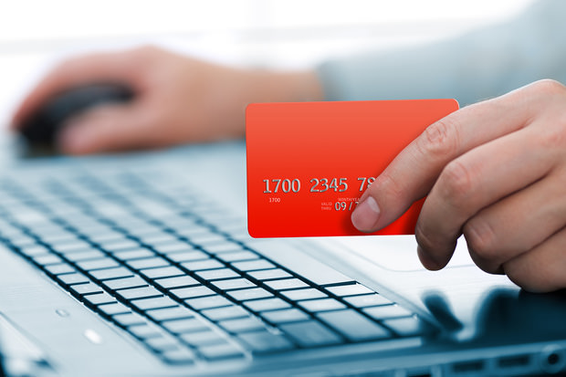 bigstock-Man-holding-credit-card-in-han-38842756